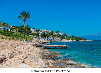 Cesme, Turkey - July 07, 2017 : People swimming and sunbathing  at Sifne Beach