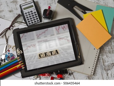 CETA word built with letter cubes on a tablet pc screen