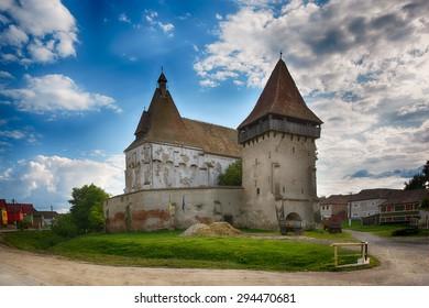 Cetatea de Balta fortified medieval church. (Kukullovar) medieval castle. Transylvania, Romania