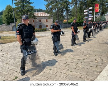 Cetinje, Montenegro, 8-22-2021: Policemen in gear form a line near the site of protests that ensued following an appointment of the new head of Serbian Orthodox Church.