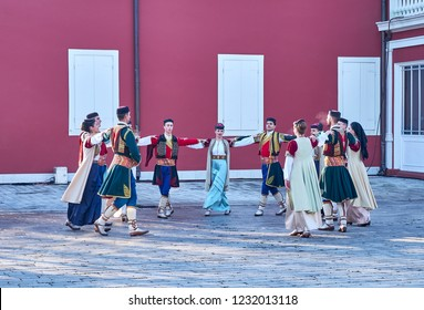 Cetinje, Montenegro, November 13, 2018.  Traditional public dance performance in the square of the former royal capital. Dancers wearing  the country's traditional folklore customs. Handheld shot