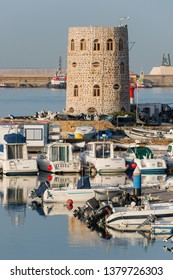 Ceuta, Spain - february 23, 2019: Tower and boats on the sports dock in the city harbor