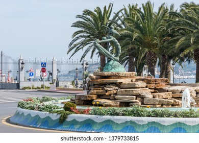 Ceuta, Spain - february 23, 2019: Sculpture and water fountain in the gardens in front of the citys port