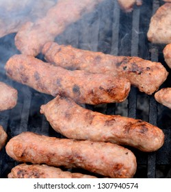 Cevapi on barbecue. Traditional Balkan food - delicius minced meat. Mici, Mititei, small Romanian minced meatrolls, similar to serbian cevapi, fresh balkan skinless sausages, cooked outside.