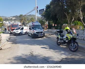 Cevat Şakir Mahallesi, Bodrum, Muğla / Turkey - 2 Feb 2019. 112 emergency team intervening in an emergency close to Myndos mall. ambulance, police and firefighters with fire truck crane