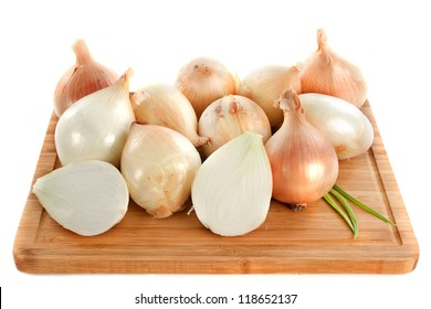 Cevennes sweet onions on a cutting board in front of white background
