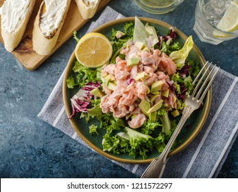 Ceviche is a traditional dish from Peru. Salmon marinated in lemon with fresh lettuce, avocado and onions.  Peruvian food.