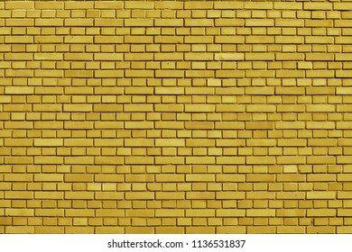 Ceylon Yellow colored brick wall background