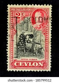 CEYLON-CIRCA 1935: An old ceylon postal stamp shows image of  tapping rubber, circa 1935