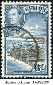 CEYLON-CIRCA 1937: An old ceylon postal stamp shows image of Colombo Harbour and King George VI, circa 1937