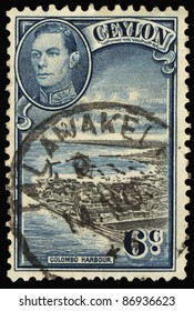 CEYLON-CIRCA 1937:A stamp printed in Ceylon shows image of The Colombo Harbour (Port of Kolomtota), King George VI, circa 1937