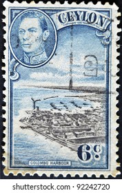 CEYLON-CIRCA 1937:A stamp printed in Ceylon shows image of The Colombo Harbour and King George VI, circa 1937