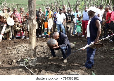 CEZA SITES, SOUTH AFRICA - November 5: Men drink traditional zulu beer at a wedding ceremony in Kwa Zulu Natal, South Africa on November 5, 2016.