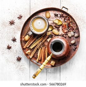 cezve and cup of coffee in copper tray with oriental spices