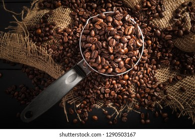 cezve with grain coffee on dark background