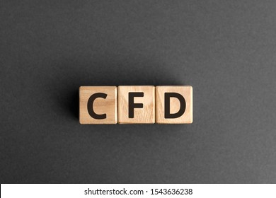 CFD - acronym from wooden blocks with letters, Contract For Difference CFD investment concept,  top view on grey background