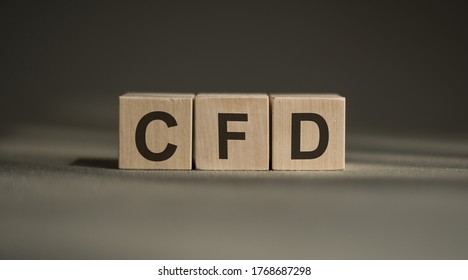 CFD - acronym from wooden blocks with letters, Contract For Difference CFD investment concept