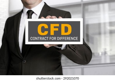 CFD sign is held by businessman.