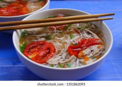 Cha ca, vietnamese fish soup with rice noodles and tomatoes