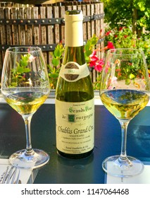 Chablis, Burgundy / France - September 29 2017: A bottle of Chablis and two glasses of chilled wine