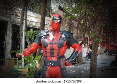 CHACHOENGSAO, THAILAND – FEBRUARY 07, 2021: Deadpool model display on the character by Marvel Comics at Wat Saman Rattanaram Temple in Chachoengsao Province of Thailand.