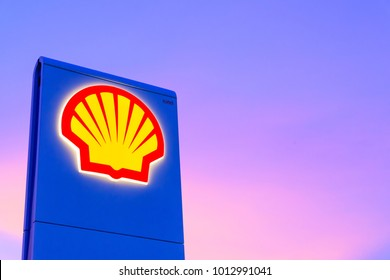 Chachoengsao, Thailand - Jan 28, 2018: Shell gas station logo with blue sky background during sunset. Royal Dutch Shell sold its Australian Shell retail operations to Dutch company Vitol in 2014