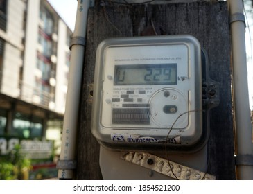 Chachoengsao, Thailand.  November 5, 2020: Digital electricity meter on the pole. Watt hour Electric meter measurement tool at apartment.