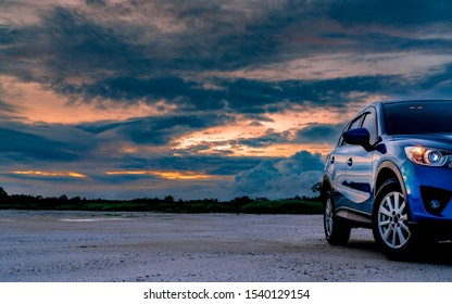 CHACHOENGSAO, THAILAND-AUGUST 4, 2019 : Mazda CX-5 with sport and modern design parked on land beside tropical forest with beautiful sunrise sky. SUV Car drive for adventure road trip. Nature landscap