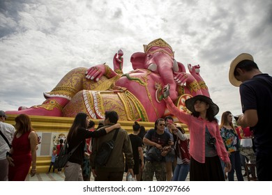 CHACHOENGSAO THAILAND-JUNE10,2018:large number of tourist taking a photograph in front of pink ganesha statue at wat saman rattanaram most popular traveling destination
