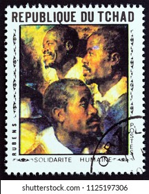 "CHAD - CIRCA 1969: A stamp printed in Chad from the ""World Solidarity, Paintings"" issue shows Three Negroes by Rubens, circa 1969."