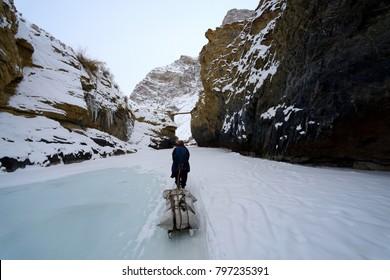 Chadar Trek or Frozen River Zanskar Trek with porters trekking in winter trail at the Zanskar region of Ladakh, in the Indian state of Jammu and Kashmir.