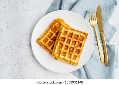 Chaffle, ketogenic diet health food. Homemade keto waffles with egg, mozzarella cheese. Gluten - free and carb-free. White background.