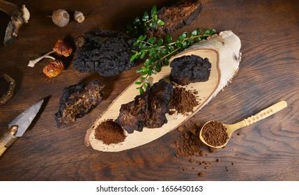 Chaga Mushroom on a wooden Table - Healthy Nutrition