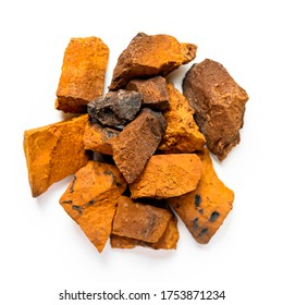 chaga mushroom. a pile of large pieces natural wild birch fungus chaga isolated on white background. top view.square