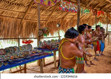Chagres National Park, Panama - April 22, 2018: Embera native people playing authentic music, dressed with traditional clothing and jewelries. Embera indigenous people live today as many decades ago.