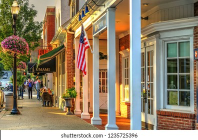 Chagrin Falls, Ohio / USA - July 15, 2015: PNC Bank and People Dining at Outdoor Sidewalk Seating at Umami on Main Street in a Beautiful Small Town