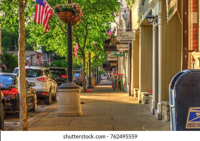 Chagrin Falls, Ohio / USA - May 30, 2017: Summer Late Afternoon Warm Sunny Scene of Sidewalk and Shops on Main Street in the Business District of Historical Downtown Chagrin Falls, Ohio