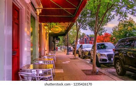 Chagrin Falls, Ohio / USA - November 2, 2017: Sidewalk Cafe Yours Truly Restaurant Silver Tables Twilight