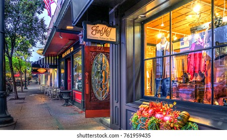 Chagrin Falls, Ohio / USA - November 2, 2017: Sidewalk View of Main Street with Quaint Upscale Shops in the Historic Village of Chagrin Falls, Ohio
