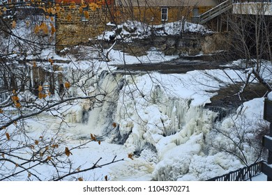 Chagrin Falls in winter, blocked by ice and snow except for the middle channel