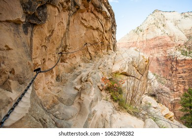 A chain attached to the canyon wall to assist hikers on the Hidden Canyon trail in Zion National Park, Utah