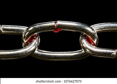 Chain in the blood of a macro is isolated on a black background, concept of slavery and imprisonment