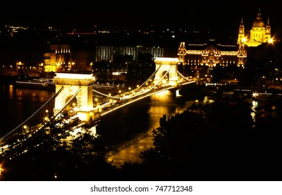 The Chain Bridge by night with St. Stephen's Basilica in the background, in Budapest, Hungary