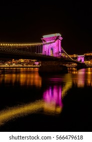 Chain bridge with lights at night in Budapest city, capital of Hungary