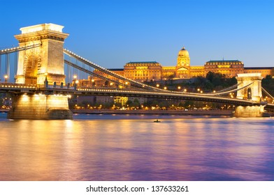 Chain bridge at night in Budapest, Hungary.