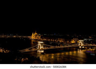 Chain Bridge over the Danube with Hungrian Parliament in background  illuminated at night, Budapest, Hungary
