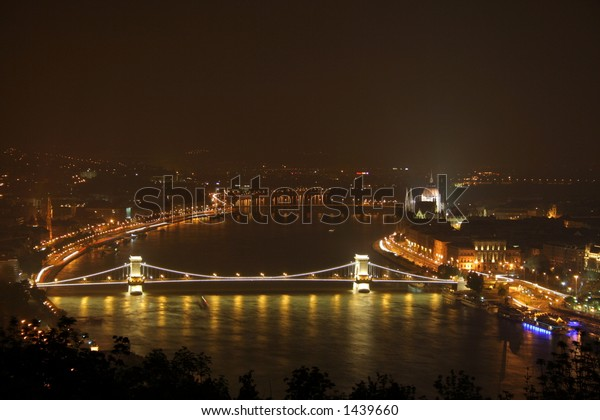 chain bridge over danube river at night