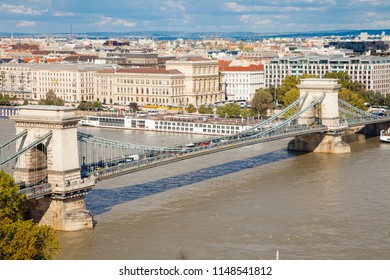 The Széchenyi Chain Bridge is a suspension bridge that spans the River Danube between Buda and Pest.