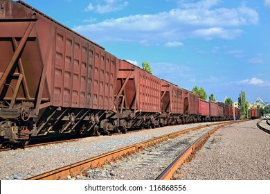 a chain of cargo wagons on a rail road