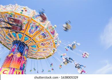 Chain carousel ride in an amusement parks carnivals or funfair, Munich, German